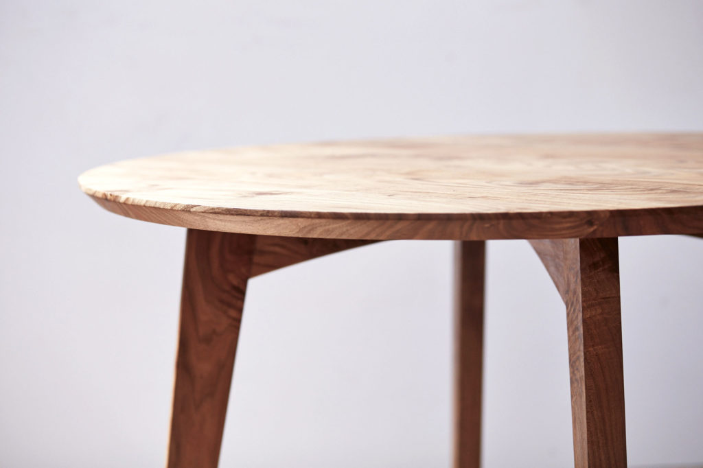 mid-century inspired contemporary circular kitchen table in Australian blackwood with chamfered edge