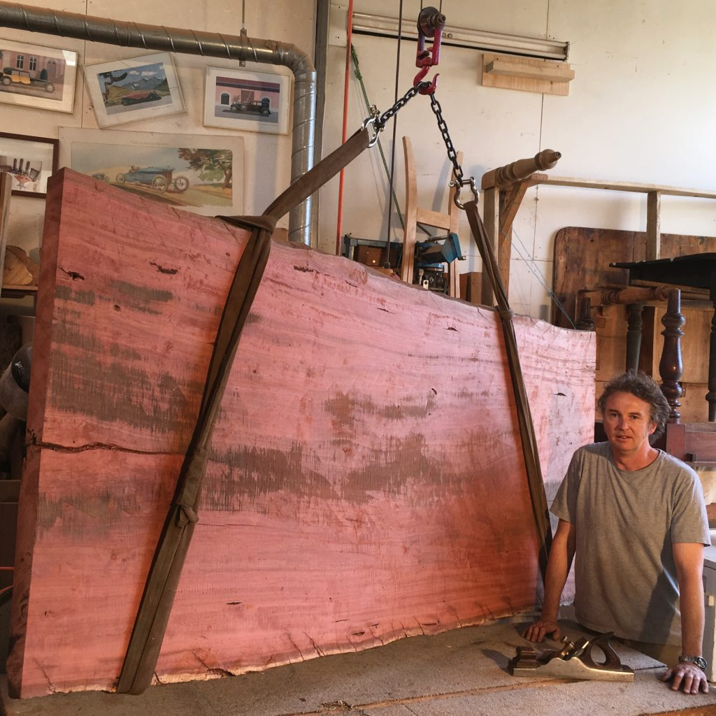 red gum slab on a sling hoist