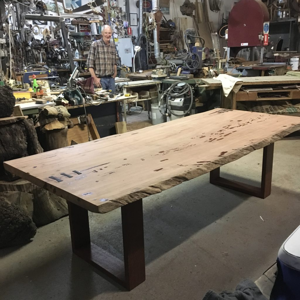 viewing red gum slab table top on the leg frame