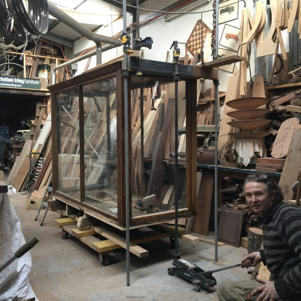 victorian glass display case during restoration process